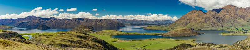 wide angle landscape photo with lakes and hills