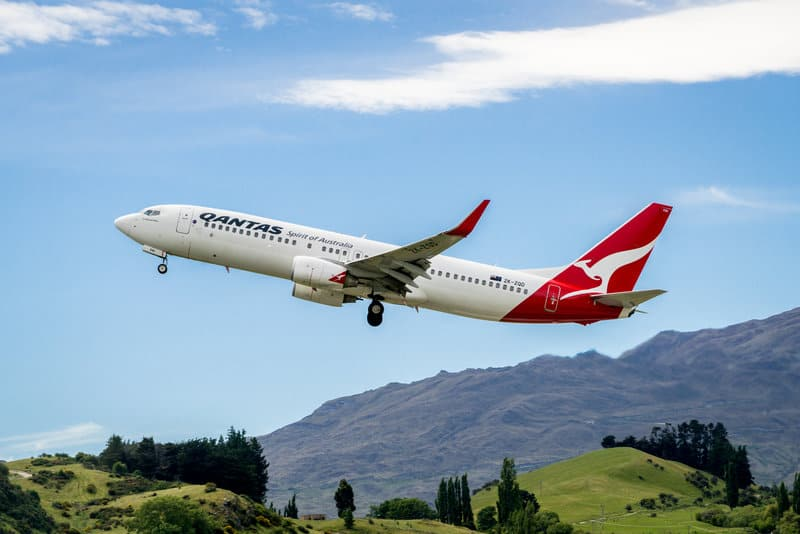 plane taking off from queenstown airport