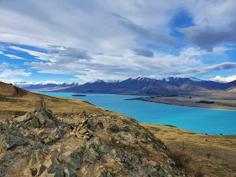 view of lake tekapo from the southern summit of mount john