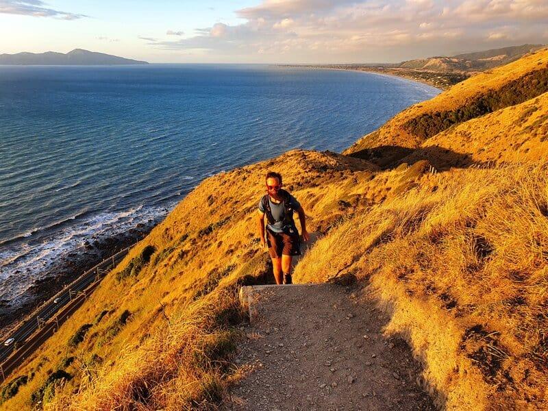 man on the paekakariki escarpment track at sunset