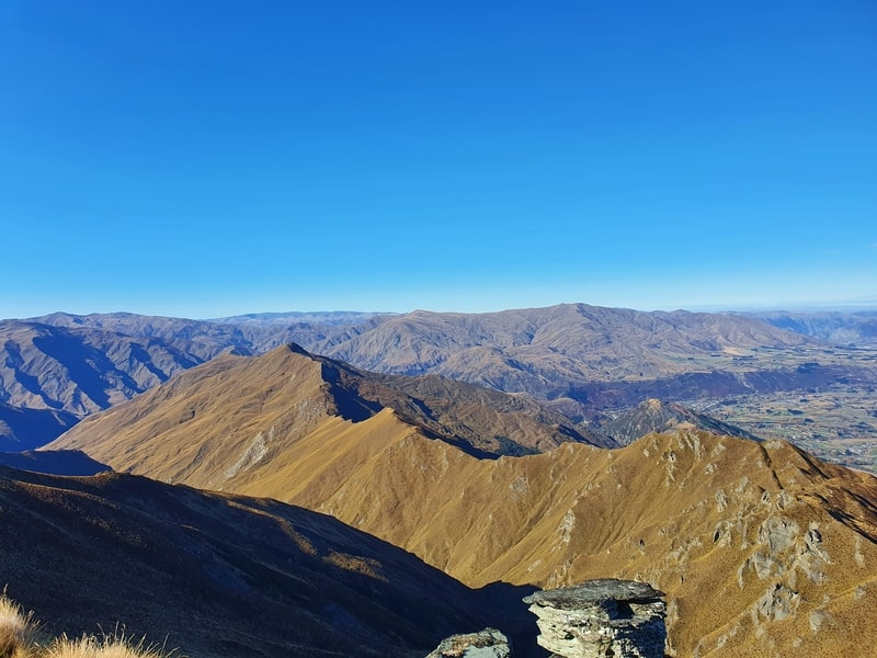 a view towards arrowtown and brow peak from coronet peak